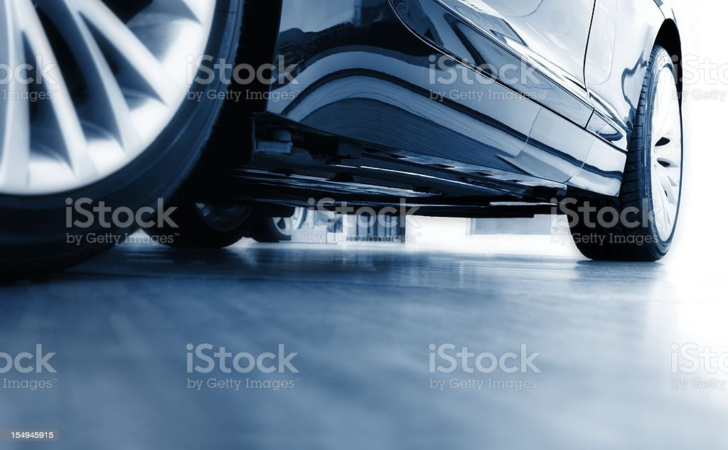 Sharp focus ground view of modern blue car stock photo