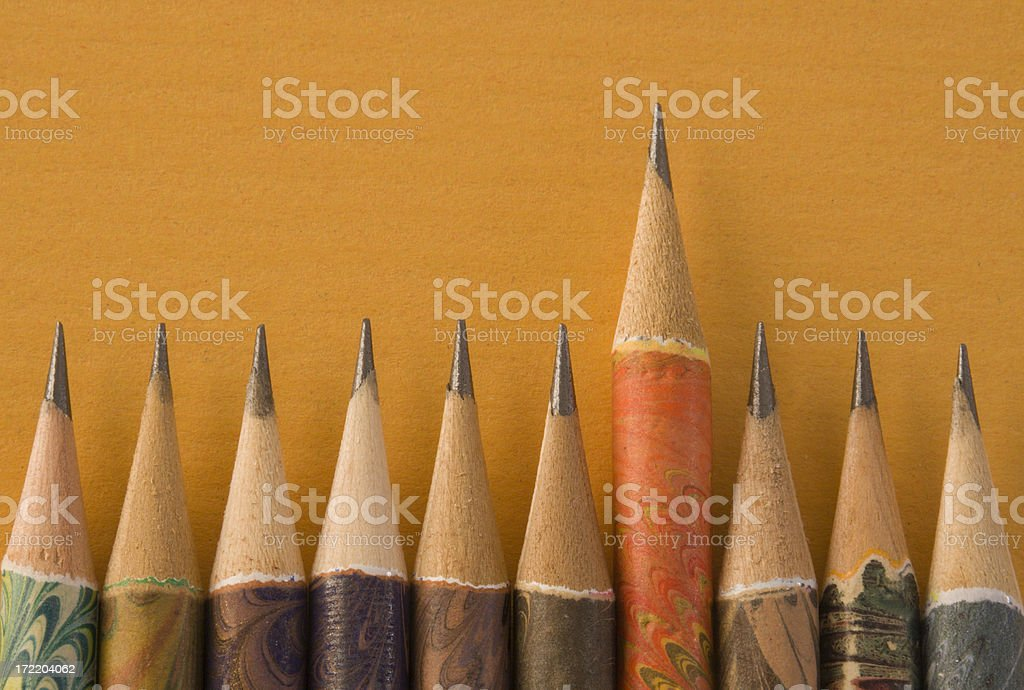 Sharp Pencil Above Peers, an Italian Writing Instrument Education Concept stock photo