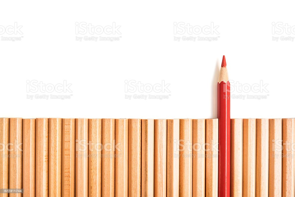 Sharp red color pencil stand out of other pencils stock photo
