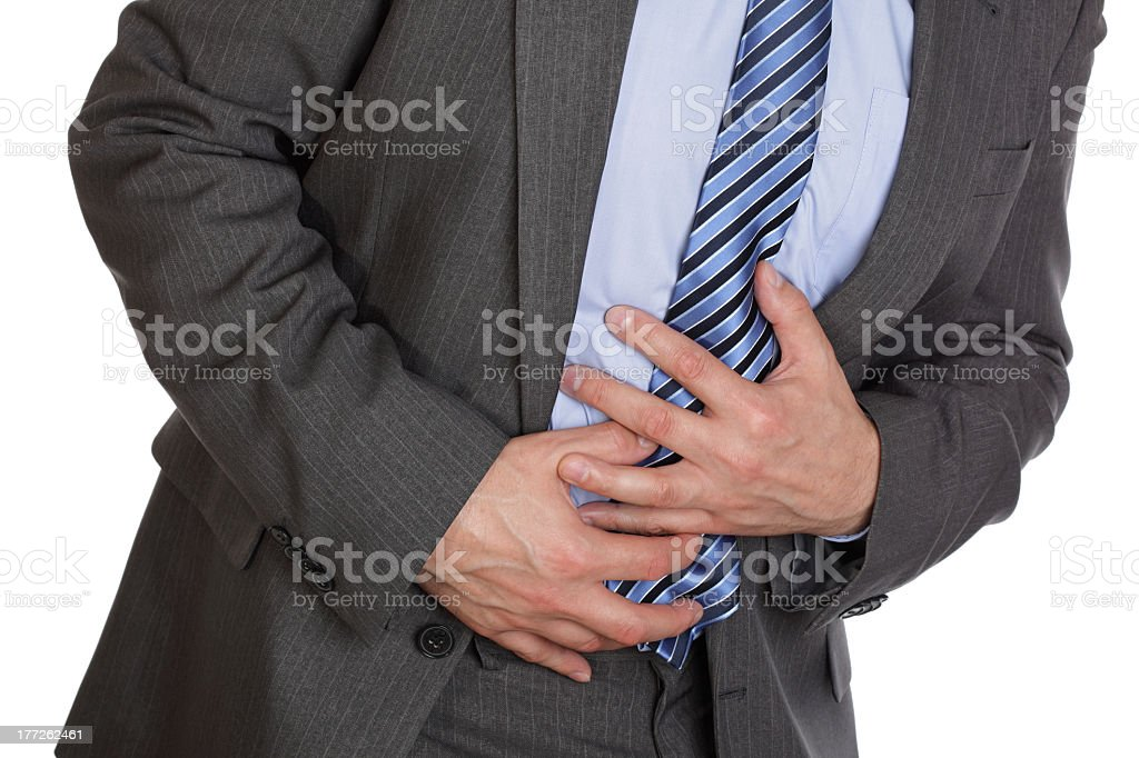 Sharp shooting pains in the stomach stock photo