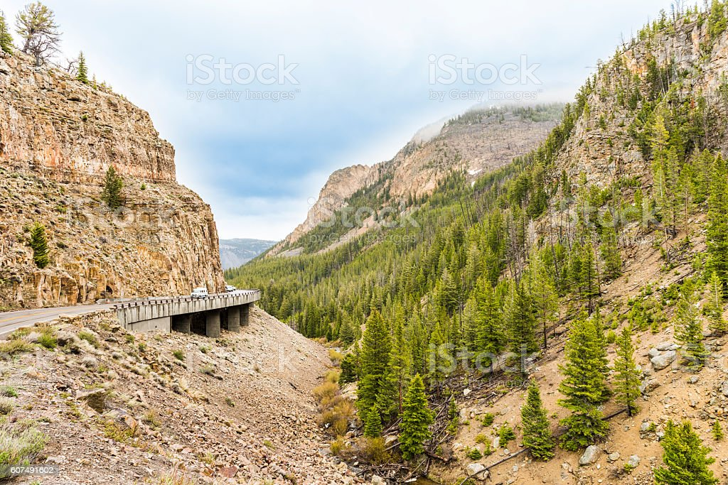 Sharp turn on road in rocky canyon mountain in Yellowstone stock photo