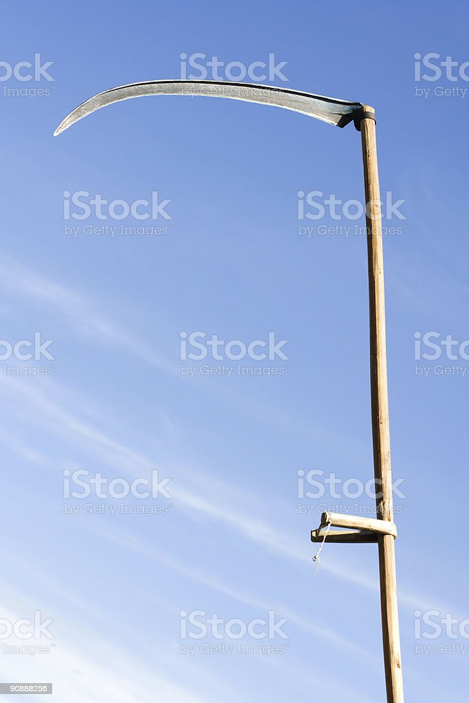 sharpen scythe stock photo