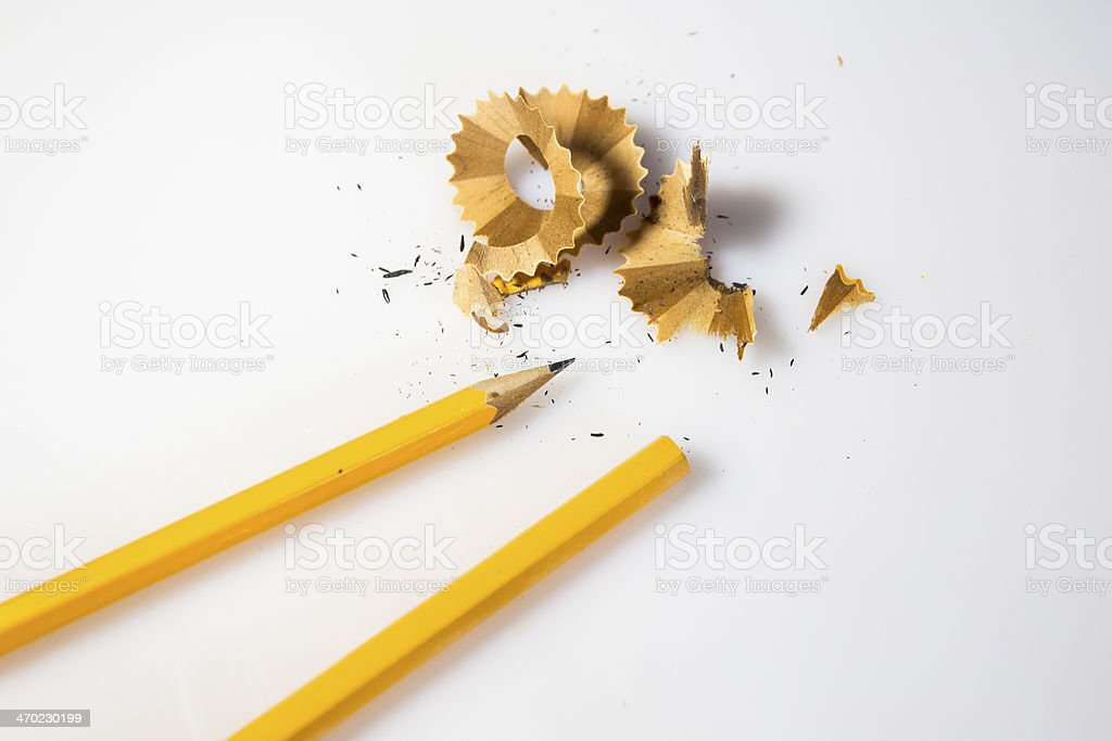sharpened pencil and wood shavings royalty-free stock photo