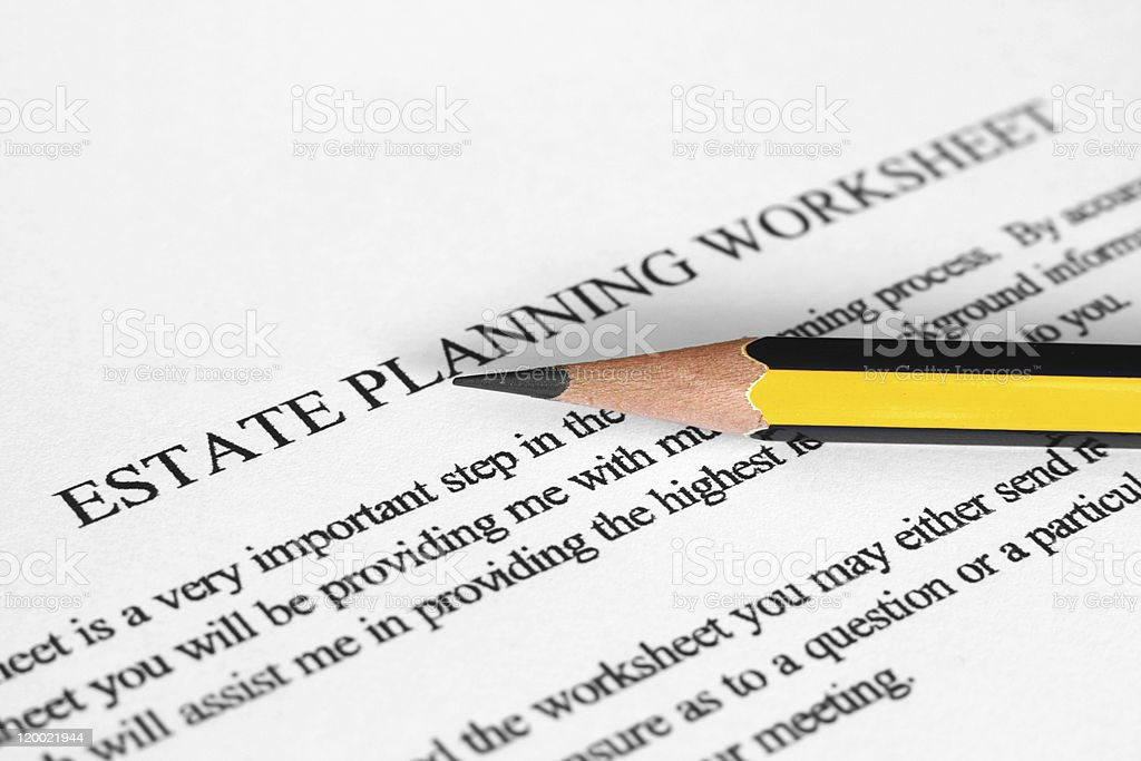 Sharpened pencil on an Estate Planning Worksheet stock photo