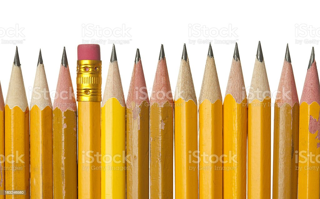 Graphite pencil tips in raw and one pencil eraser isolated on...