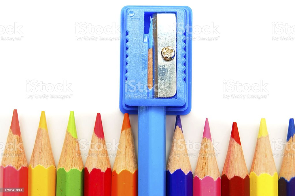 Sharpener and pencils on white background. royalty-free stock photo