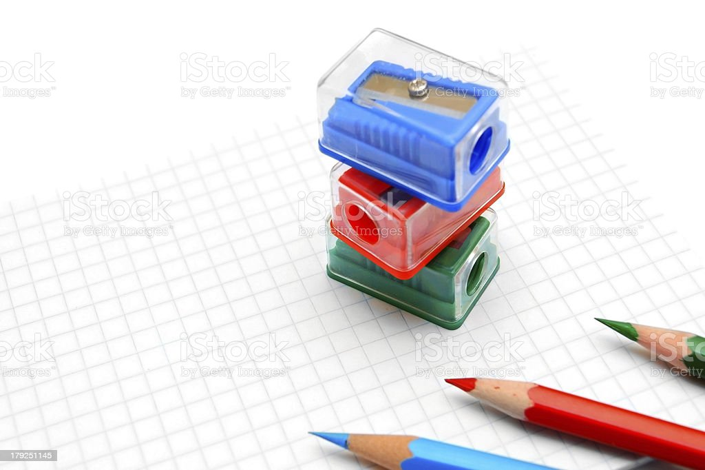 Sharpeners and pencils on a white background. royalty-free stock photo