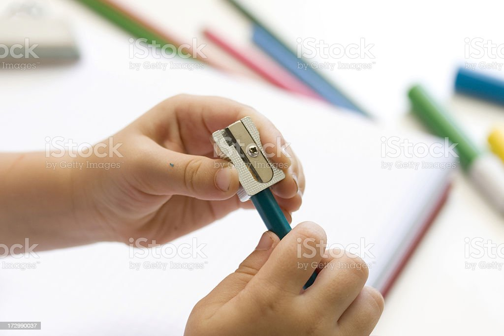 Sharpening a pencil stock photo
