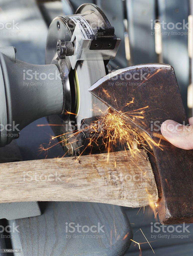 Sharpening an Old Axe stock photo