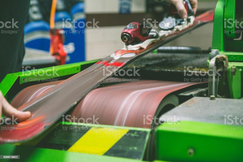sharpening of an edging of mountain skis stock photo