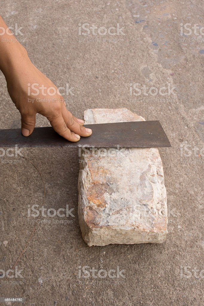 sharpening the knife with whetstone stock photo