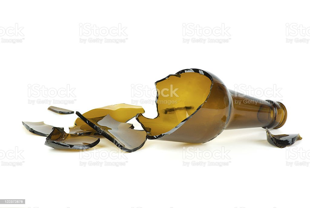 Shattered brown beer bottle royalty-free stock photo