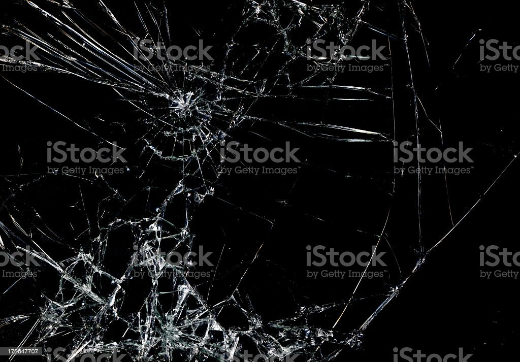 Shattered glass in dark background stock photo