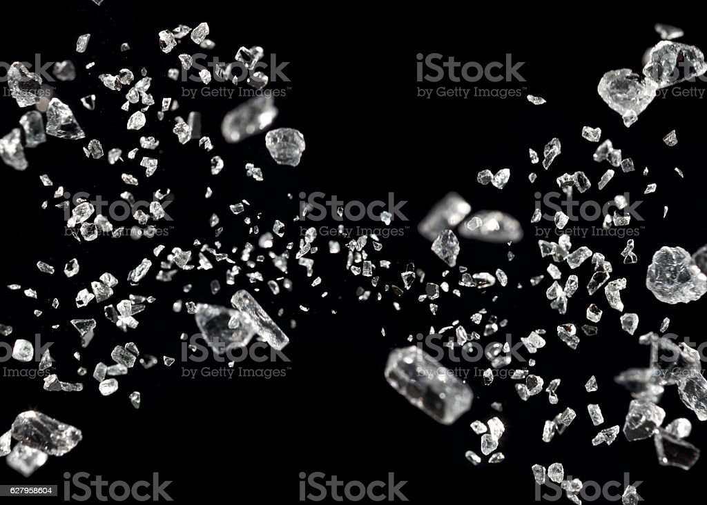 shattered glass in motion stock photo