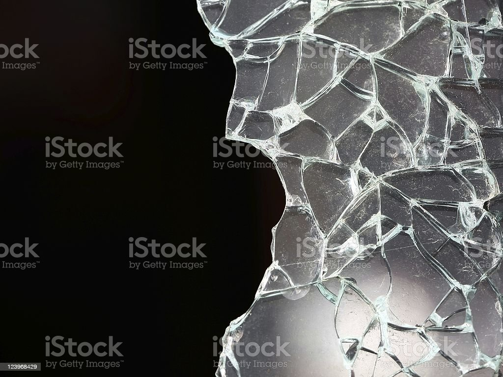 Shattered glass on a black background stock photo