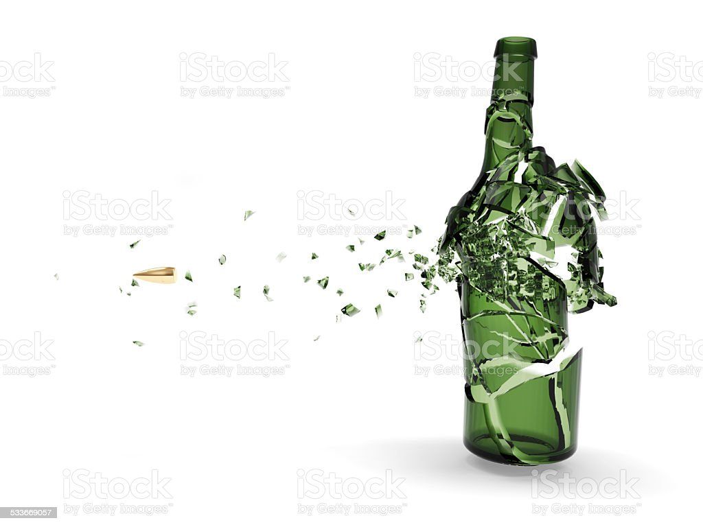 Shattered green beer bottle by bullet isolated on white background. stock photo
