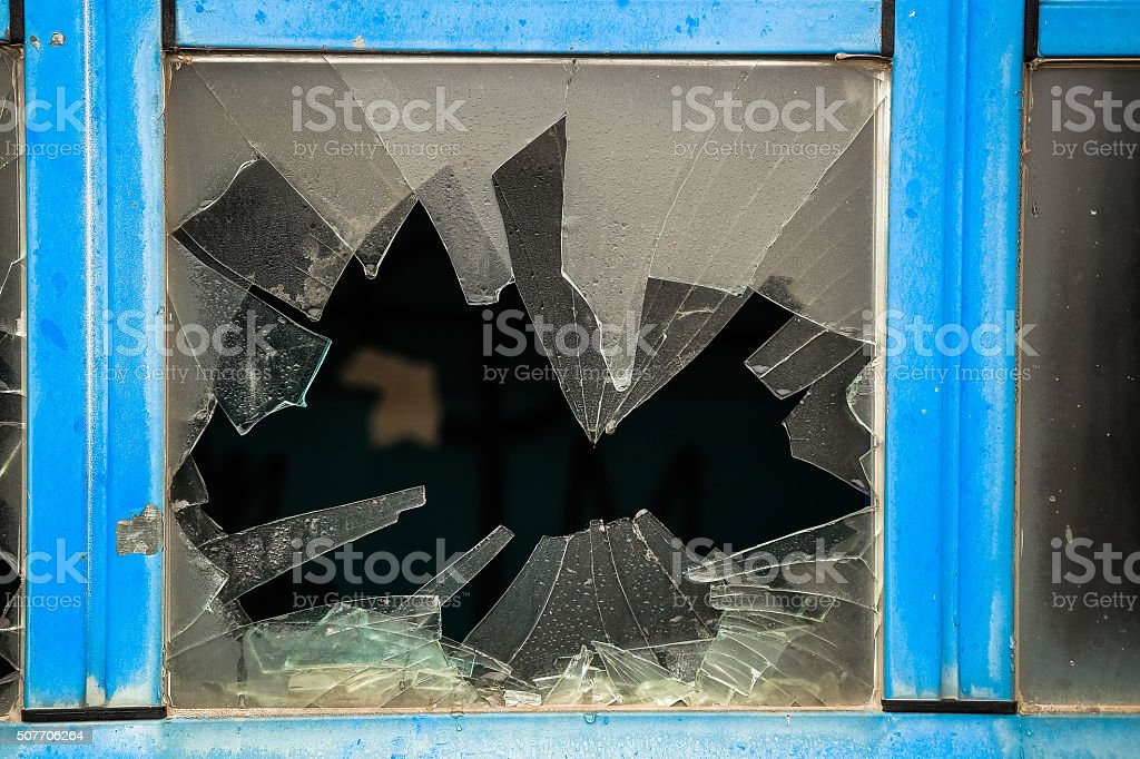 Shattered window glass stock photo