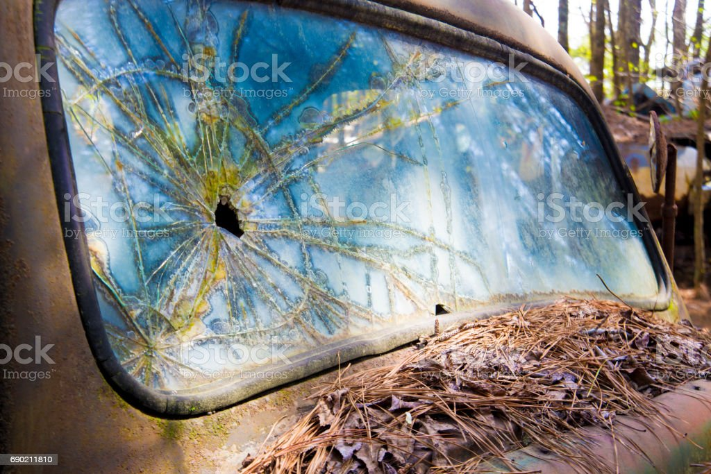 Shattered windshield in old abandoned truck. stock photo