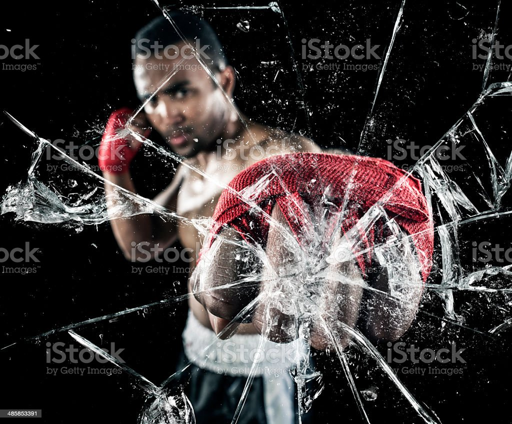 Shattering glass with punch stock photo
