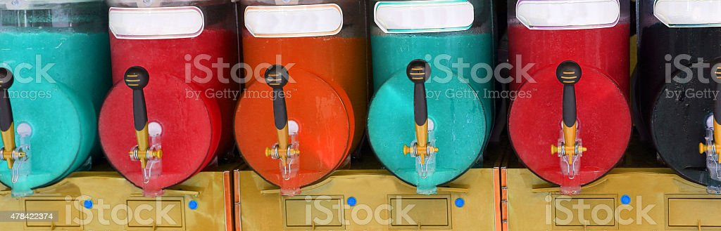 shave ice machine with many colored flavors stock photo