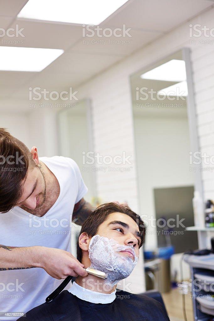 Shaving at the salon stock photo