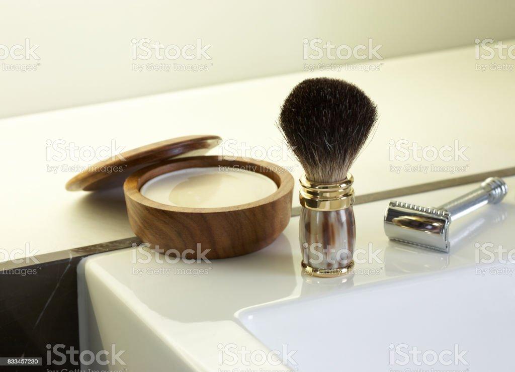 Shaving brush, traditional safety razor, and shaving soap stock photo
