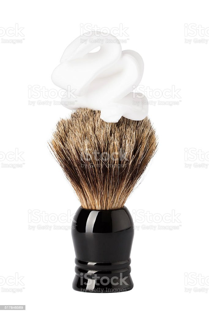 Shaving brush with foam isolated on white stock photo
