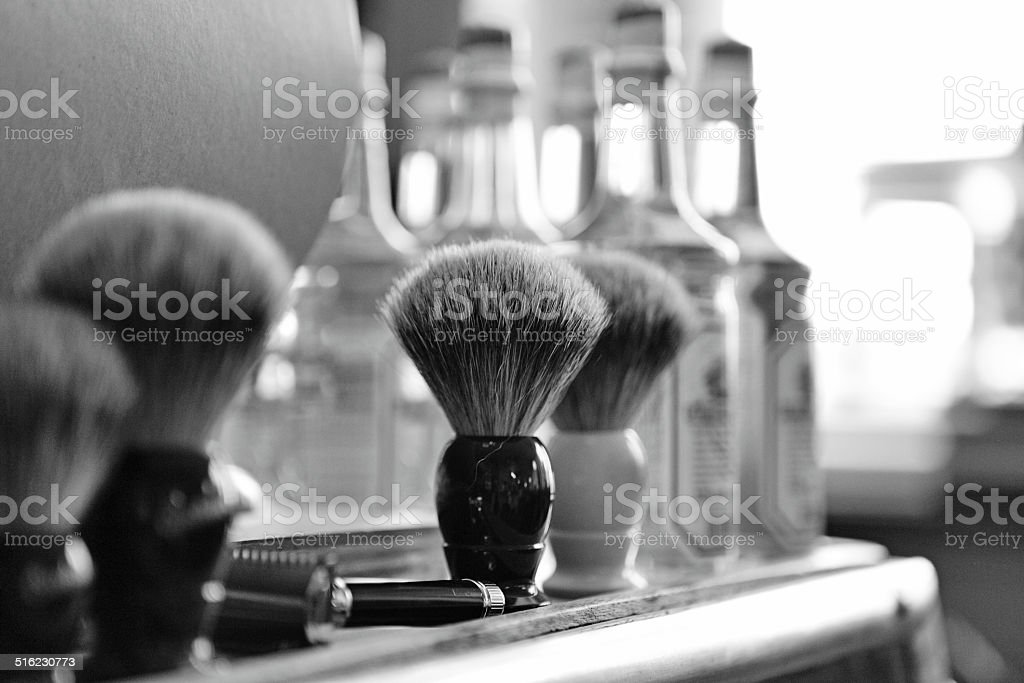 shaving brushes at barbershop stock photo