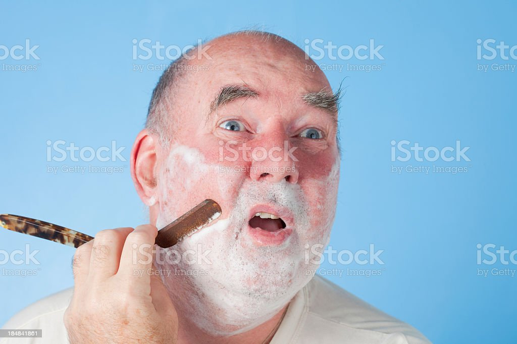 Shaving Dangerously royalty-free stock photo