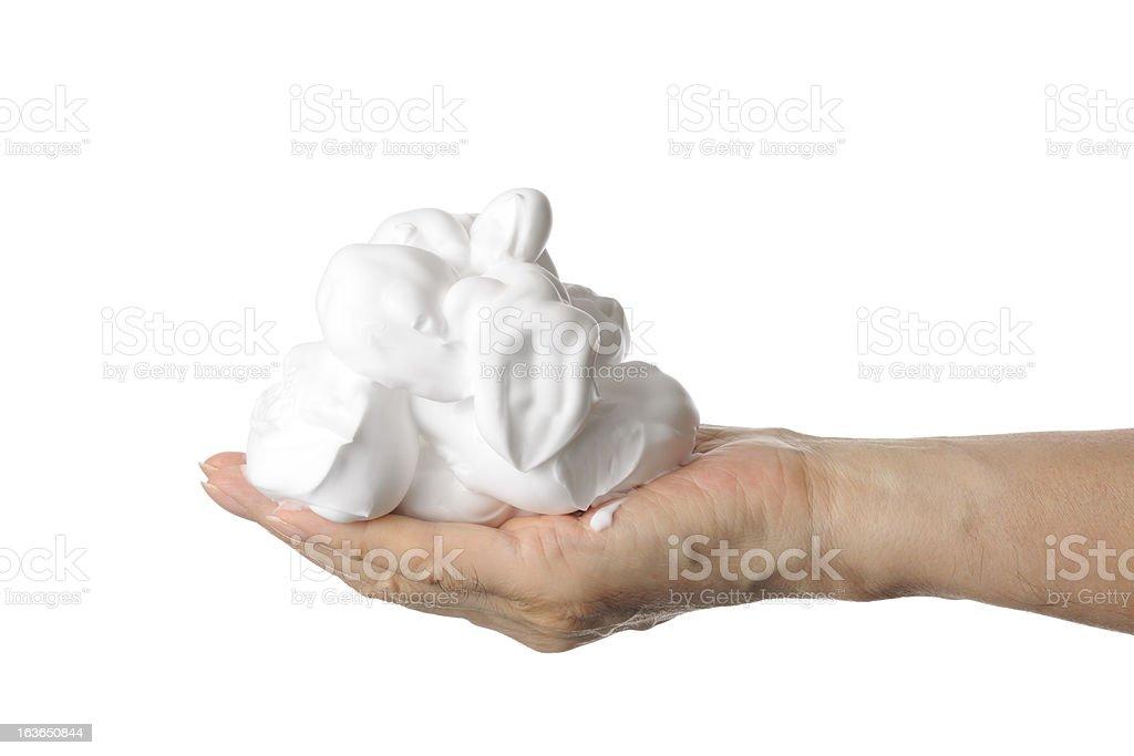 Shaving foam on the hand against white background stock photo