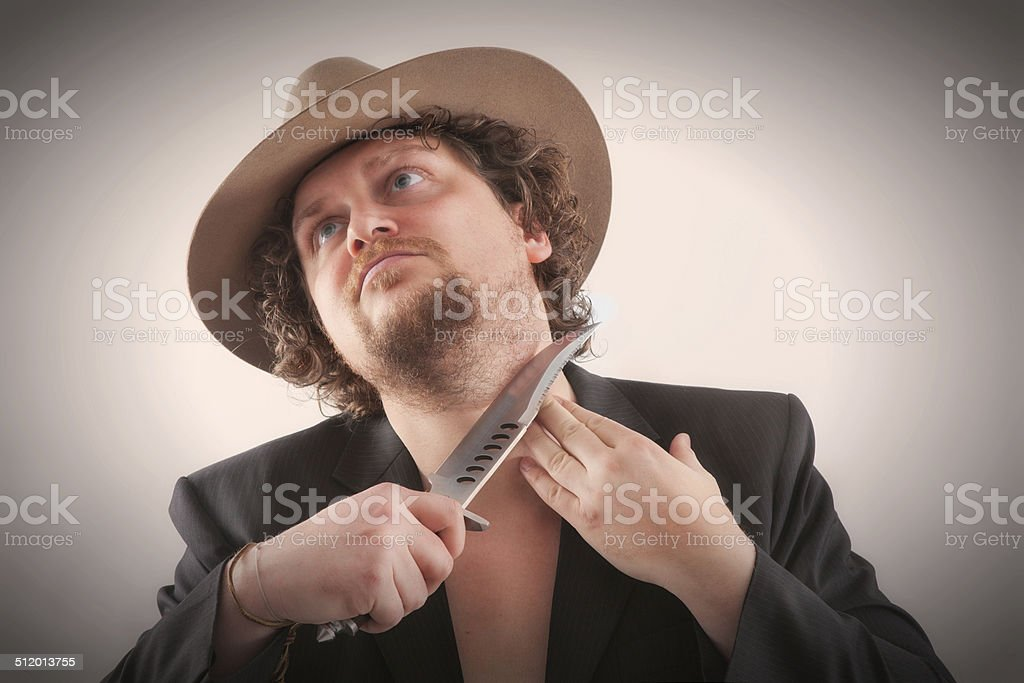 Shaving man with a hat stock photo
