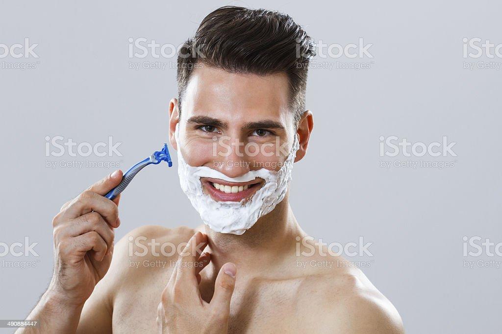 Shaving the beard royalty-free stock photo