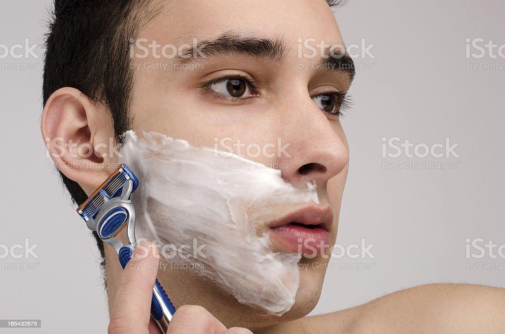 Shaving  the beard with a razor. royalty-free stock photo