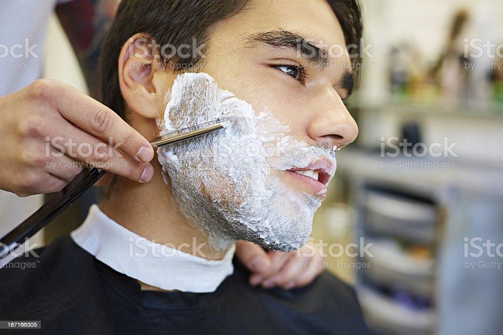 Shaving with razor royalty-free stock photo