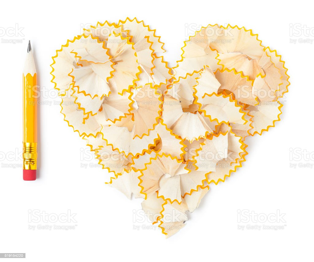 Shavings heart with pencil on white stock photo
