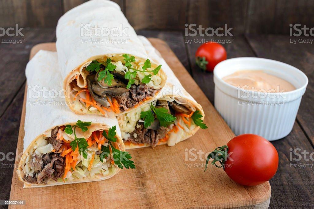 Shawarma sandwich - fresh roll of thin lavash (pita bread) stock photo