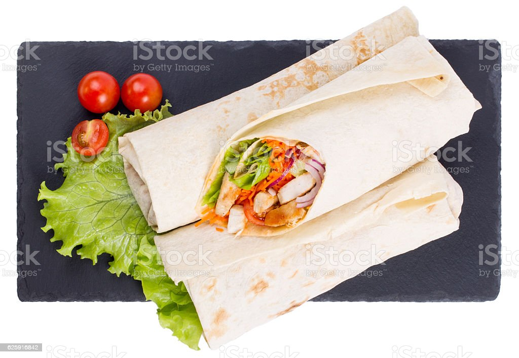 Shawarma with meat on a serving dish are isolated stock photo