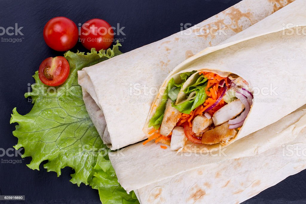 Shawarma with meat on a serving dish stock photo