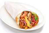 shawarma with sauce on white background