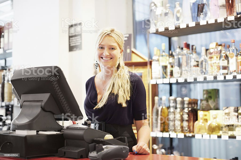 She always gives service with a smile stock photo