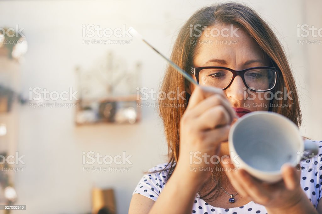 She always pays attention to the little details stock photo
