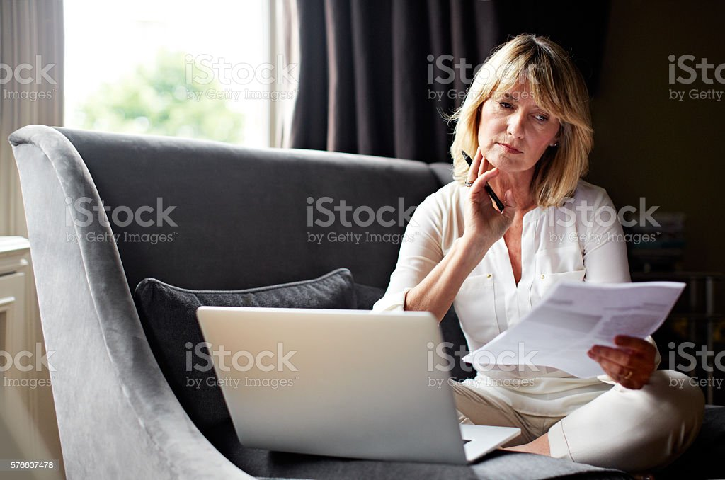 She always reads the fine print stock photo