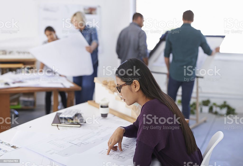 She always reviews every detail of her work before submitting royalty-free stock photo