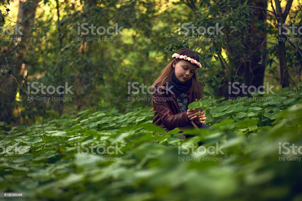 She believes in nurturing nature stock photo