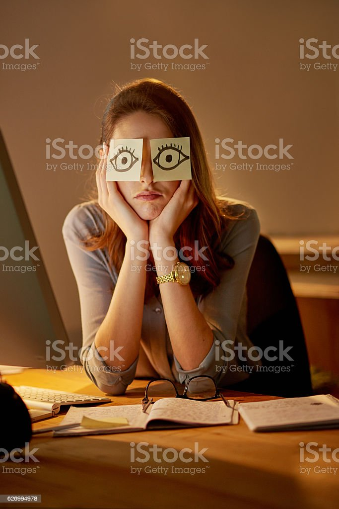 She can't keep her eyes open stock photo