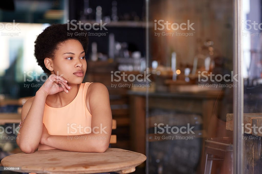 She comes to the cafe to think stock photo