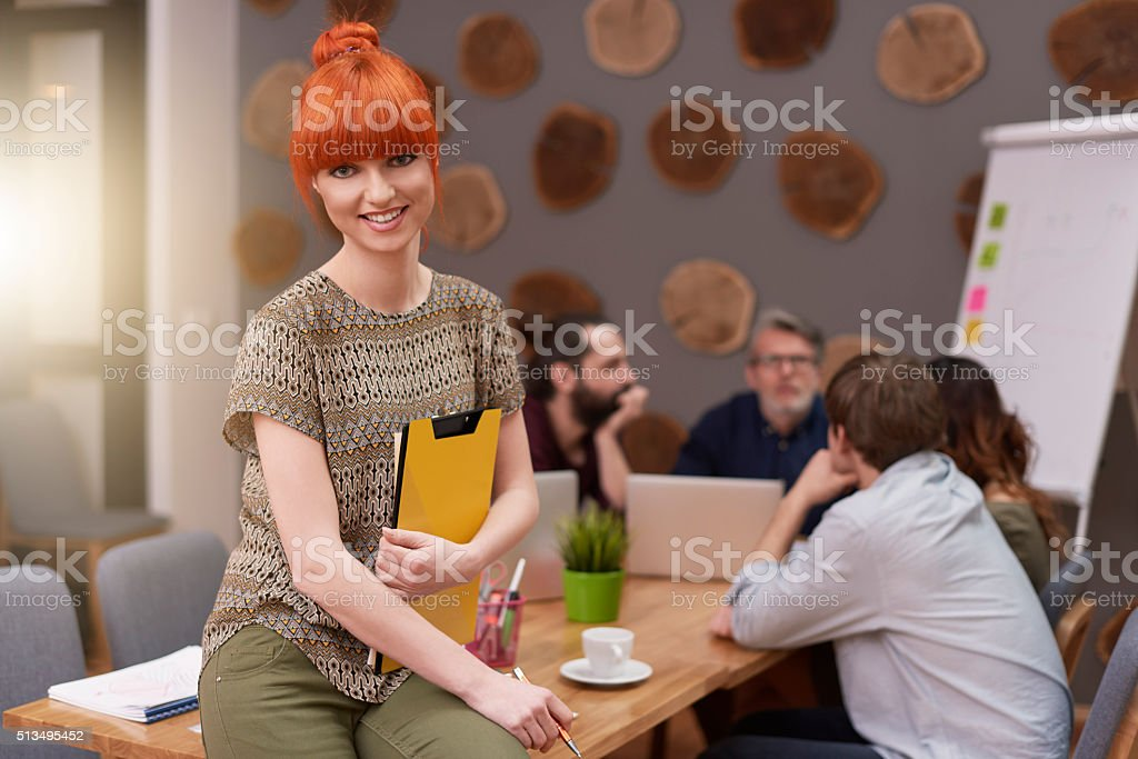 She definitely likes this work stock photo