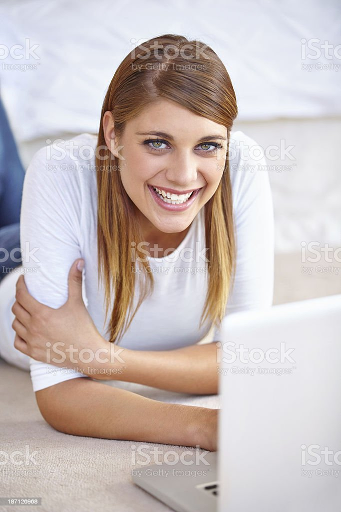 She enjoys chatting online! stock photo