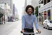 She enjoys cycling through the city