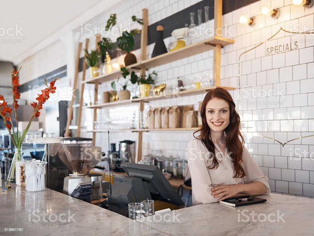 She enjoys running her own business stock photo
